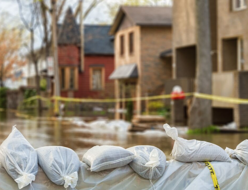 flooded homes with sandbags